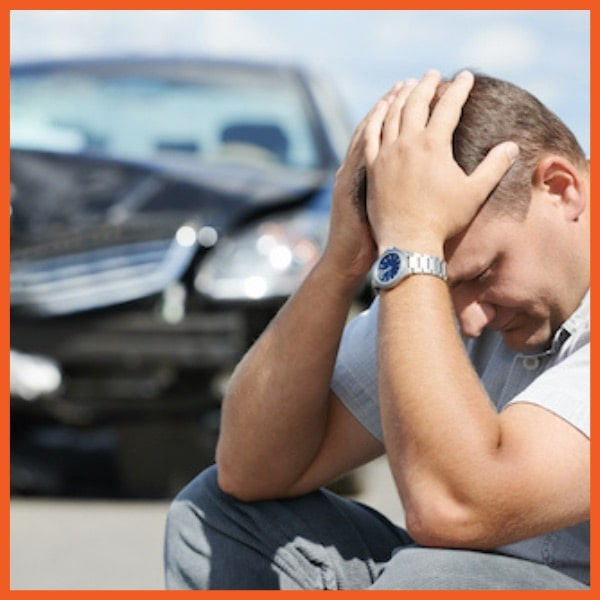 Man Frustrated with Car in Background