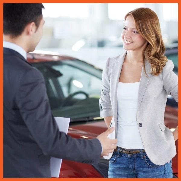 Woman Buying New Car at Dealer