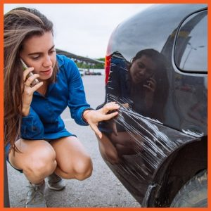 CPI - Woman Looking at Car Scratches