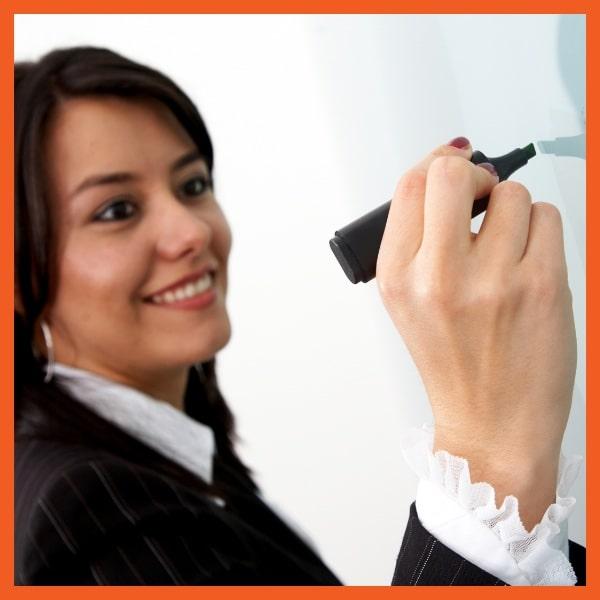 Executive Benefits Education - Woman Writing on Board