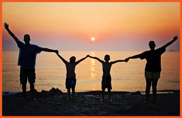 Direct Insurance - Family Holding Hands Along Coast