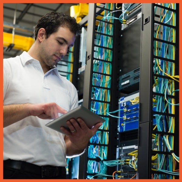 Equipment Management System - Man Working in Server Room