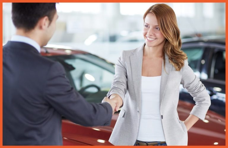 Equity Protection - Woman Shaking Hands at Car Dealer