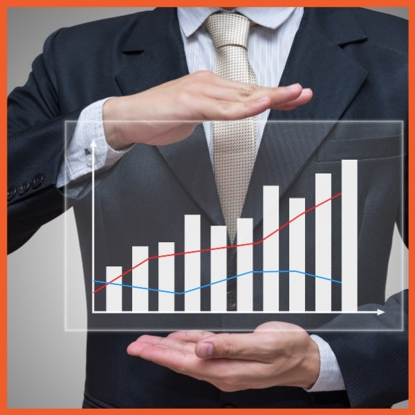 Payment Protection - Fee Income - Businessman Holding Graph